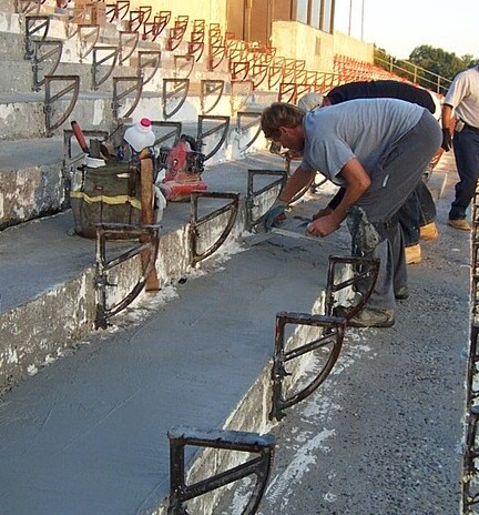 Applying Super Color Stain to exposed concrete.